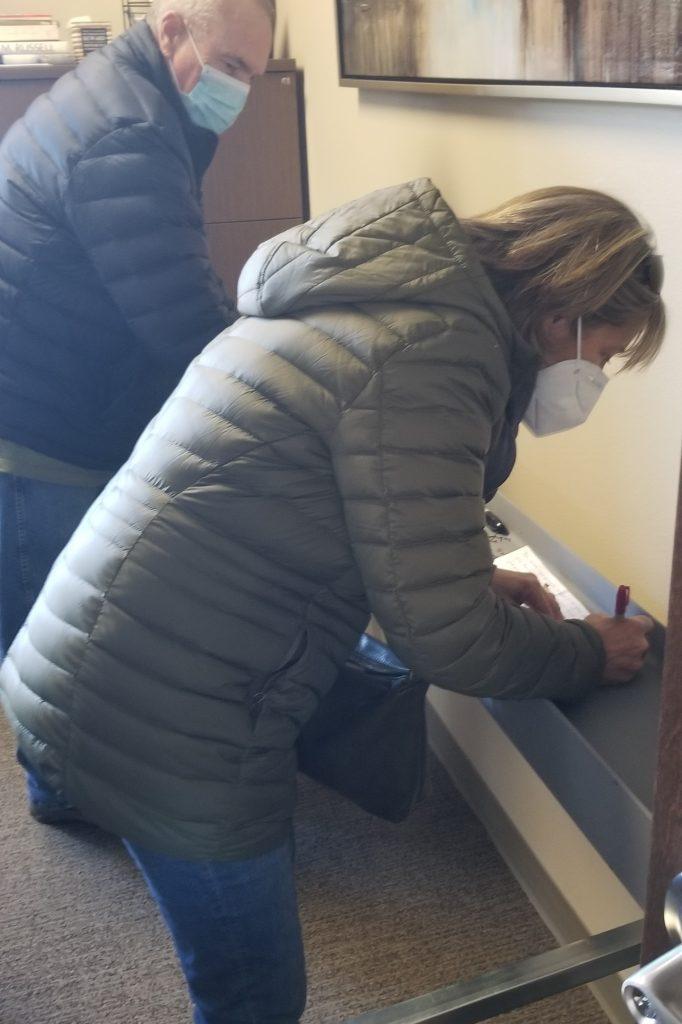 Photo of Ed and Karen Venetz signing the beam